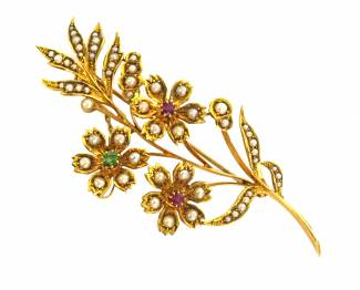Grays Antiques Victorian yellow gold flower spray brooch set with seed pearls, rubies and emeralds, £550